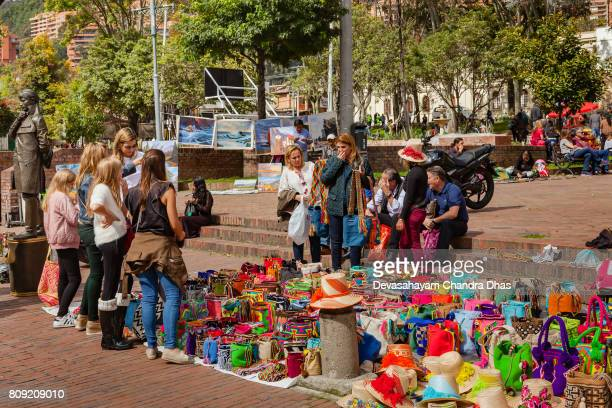 Bogotá, Colombia - The Weekly Mercado de Las Pulgas in the Popular, Historic Usaquén Town Square on a Bright Sunday Afternoon. Arhuaca Mochila and Paintings for Sale