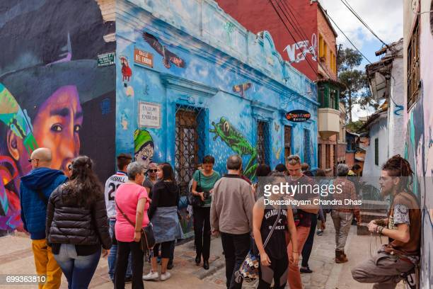 Bogotá, Colombia - Tourists and Local Colombian People on the Narrow Calle Del Embudo in the Historic La Candelaria District of the Andean Capital City