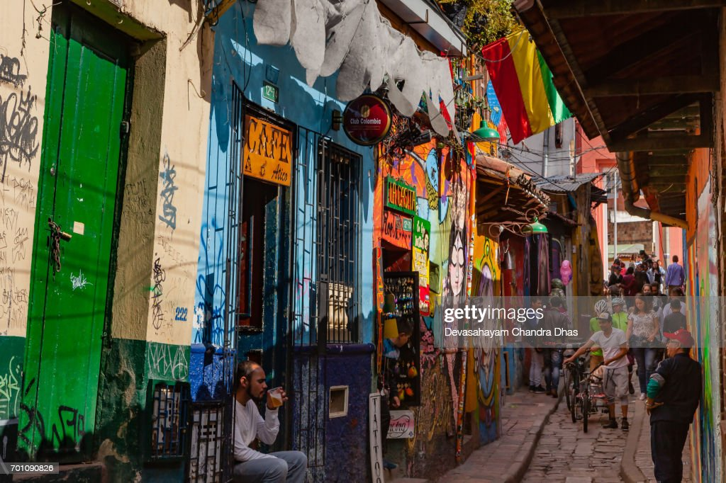 Bogotá, Colombia - Tourists and Local Colombians on the Narrow, Cobblestoned Calle del Embudo : Stock Photo