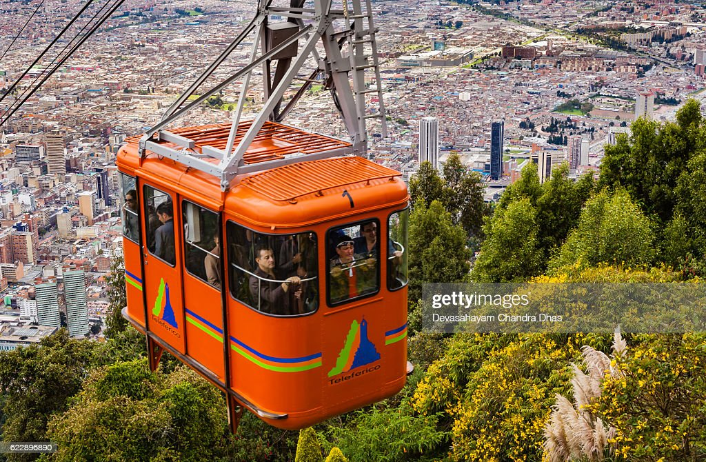 Bogota, Colombia - Cable Car approaching Andean peak of Monserrate : Stock Photo