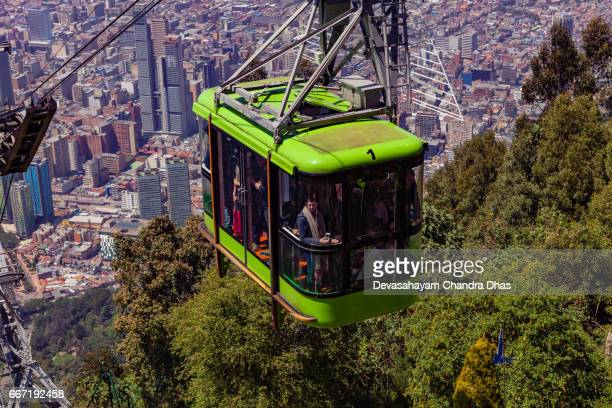 Bogota, Colombia - A Cable Car Carrying Tourists Approaches Monserrate Peak  the Andean Capital City