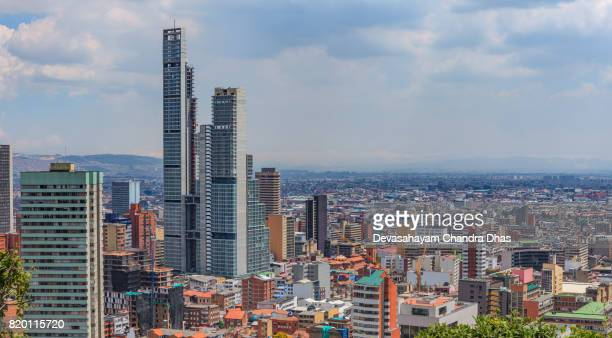 bogota, colombia: high angle view of the south american capital city on the andes mountains - bd bacatá tallest man made structure in colombia can be seen to the left - latin america stock pictures, royalty-free photos & images