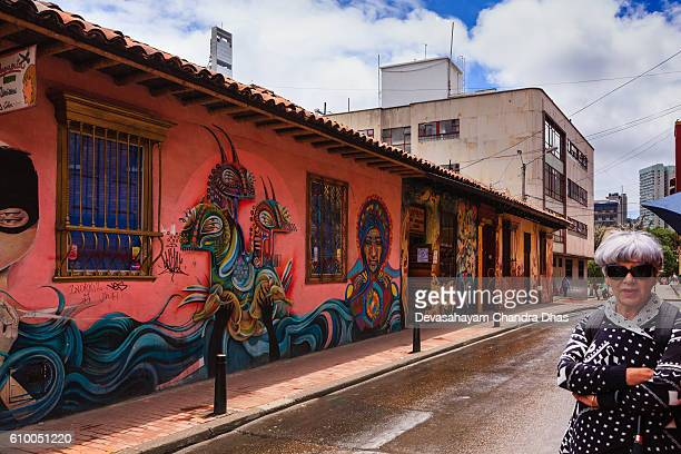 Bogota, Colombia - Lady and Street Art in La Candelaria