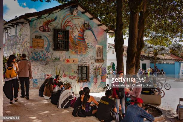 Bogota, Colombia - Local Colombian People and a Few Tourists Enjoying the Plaza Chorro de Quevedo