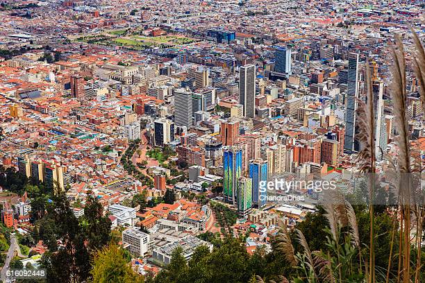 bogota, colombia: the andean capital city as viewed from monserrate; to the left is historic la candelaria and to the right the modern down town area - bogota stock pictures, royalty-free photos & images