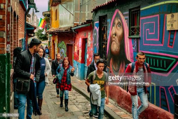 Bogota, Colombia - Tourists and Local Colombians on the Calle del Embudo, in the Historic La Candelaria District of the Andean Capital City