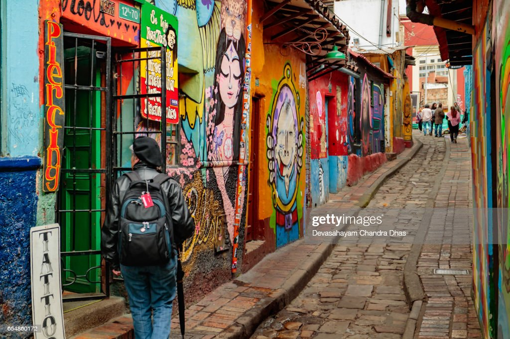 Bogota, Colombia - Tourists and Local Colombians on the Calle del Embudo, in the Historic La Candelaria District of the Andean Capital City : Stock Photo