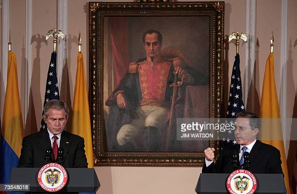 US President George W Bush listens as Colombian President Alvaro Uribe speaks during a joint press conference at the Casa de Narino presidential...