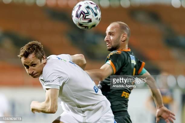 Bohdan Butko of Buyuksehir Belediye Erzurumspor in action against Efecan Karaca of Aytemiz Alanyaspor during the Turkish Super Lig week 41 match...