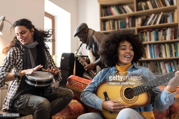 Boho band playing different musical instruments and singing