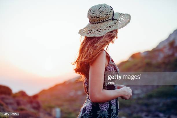 Boho girl enjoying nature with summer sunflare