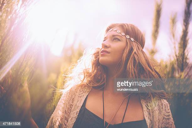 Boho girl in nature with sun flare