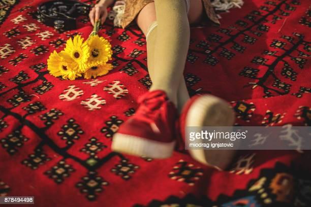 Boho girl lying down on the carpet