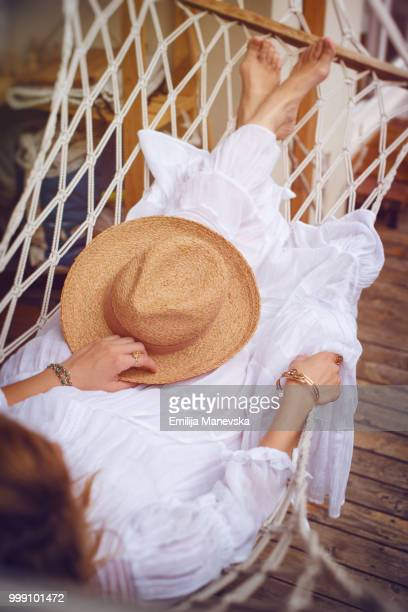 boho girl lying in a summer hammock - gypsy stock pictures, royalty-free photos & images