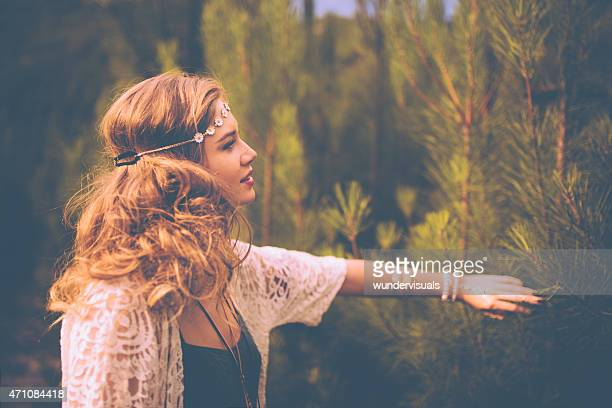 Boho girl surrounded by nature in summer