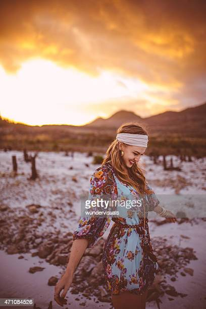 Boho girl walking in nature on a summer evening