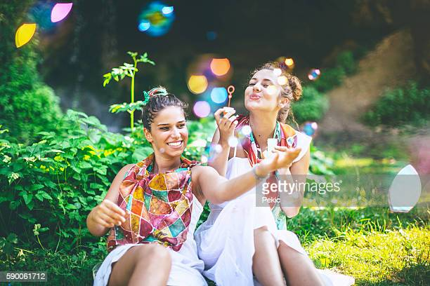 Boho girls surrounded by nature in spring
