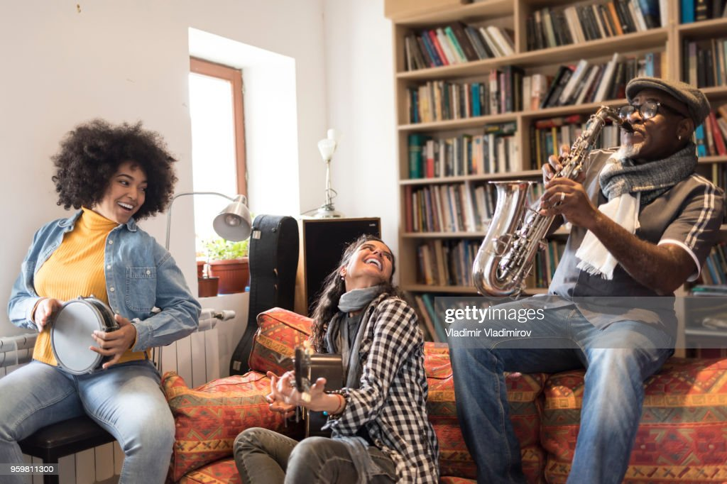 Boho musicians playing instruments and singing : Stock Photo