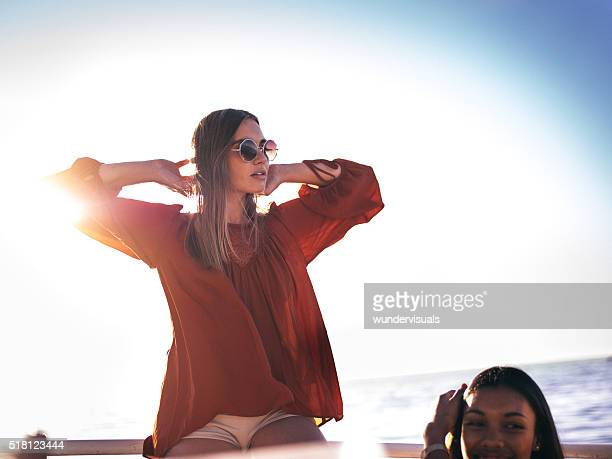 Boho style girl relaxing on summer day with sunflare