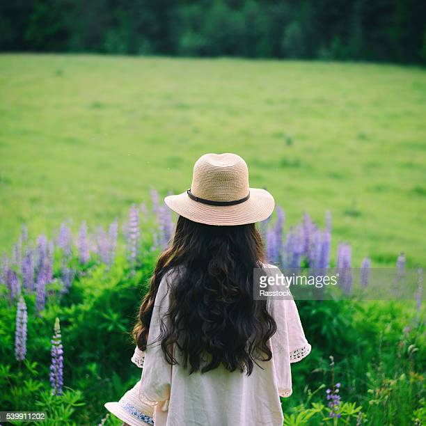 Boho style girl with long hair on nature background