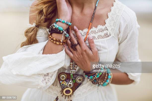 boho woman with multicolored jewelry - jewelled stock pictures, royalty-free photos & images