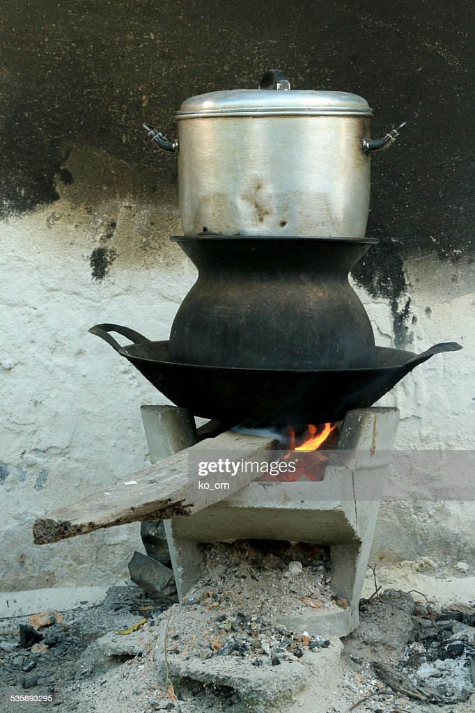 Boil steam pot on bon fire stove : Stock Photo