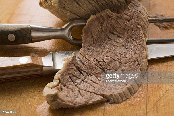 Boiled beef with a slice cut