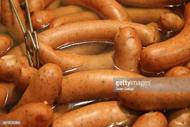 Boiled bockwurst sausages await visitors at a stand at the International Green Week agricultural trade fair on January 16 2015 in Berlin Germany The...