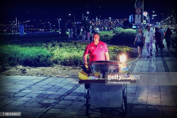 boiled corn vendor by the waterfront at night,izmir. - emreturanphoto stock pictures, royalty-free photos & images