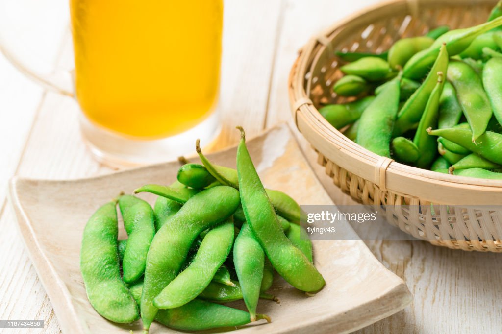 Boiled edamame and draft beer : Stock Photo
