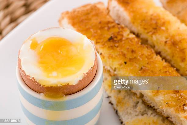 boiled egg and soldiers close up - hard boiled eggs stock pictures, royalty-free photos & images