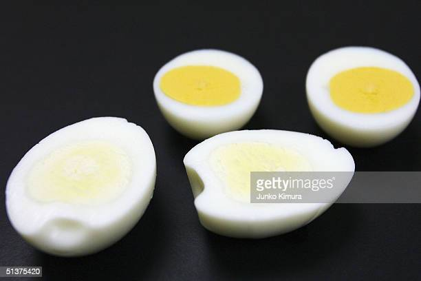 A boiled egg with a whiter yolk is seen next to an ordinary boiled egg at the QP Corp Research and Development centre on September 30 2004 in Tokyo...