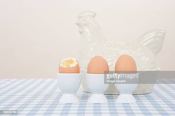 boiled eggs and a porcelain hen - hard boiled eggs stock pictures, royalty-free photos & images