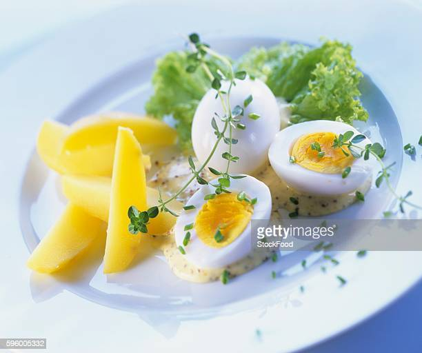 Boiled eggs with mustard sauce and boiled potatoes