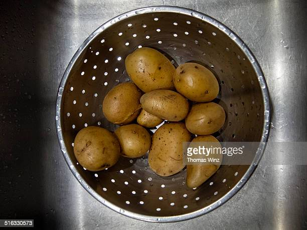 Boiled organic potatoes in a strainer