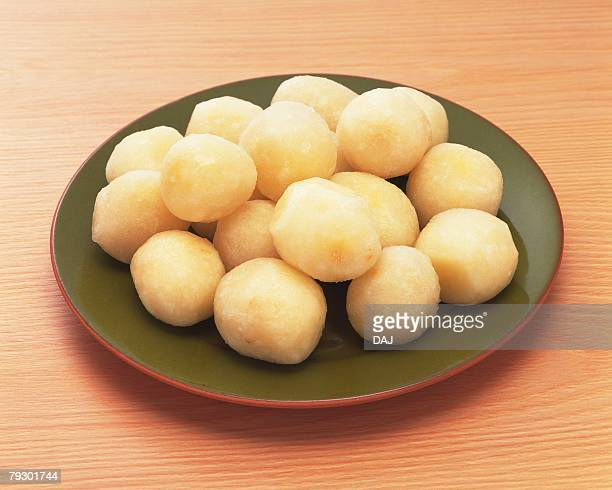 Boiled potatoes on plate, high angle view