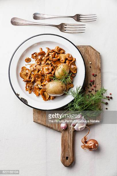 Boiled potatoes with roasted wild mushrooms