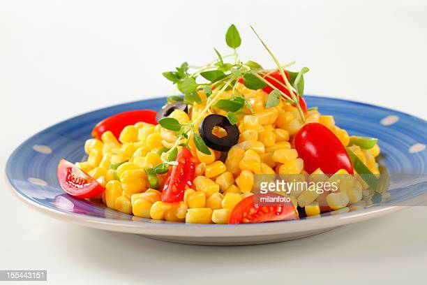 Boiled sweetcorn with tomatoes and olives