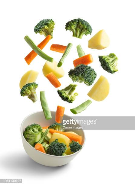 boiled vegetables flying on white background. creative concept - flying stock pictures, royalty-free photos & images