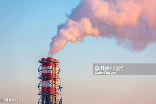 boiler house's chimney and steam - district heating plant stock pictures, royalty-free photos & images