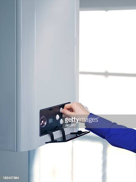 Boiler uses the woman's hand