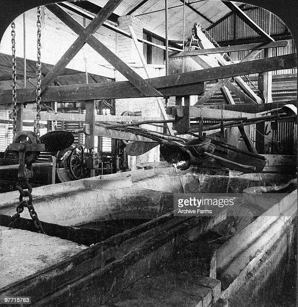 Boiling coppers Weitz pan and crane in the old style sugar mill Mona Sugar Plantation Jamaica