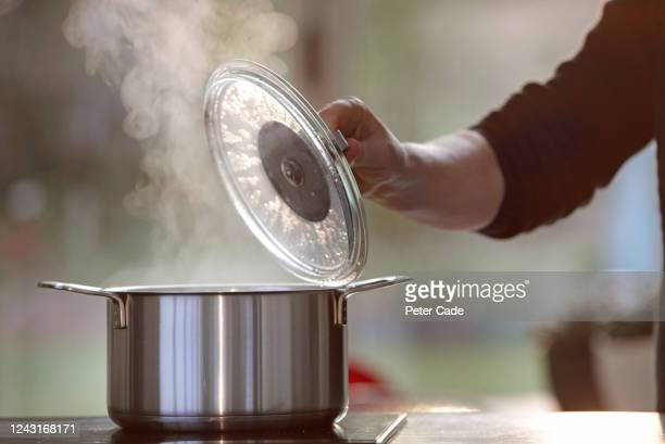 boiling pan on hob - electric stove burner stock pictures, royalty-free photos & images