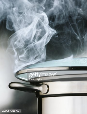 Boiling Pot Of Water Steam Rising Through Lid Closeup ...