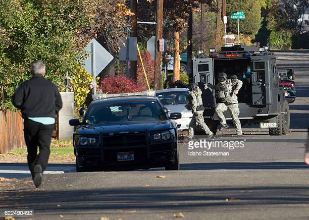 Boise police and SWAT team respond to shots fired in an alley along Irving Street in Boise Idaho on Friday Nov 11 during a manhunt for a fugitive...