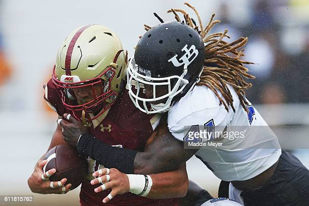 Boise Ross of the Buffalo Bulls tackles Tyler Rouse of the Boston College Eagles during the second quarter at Alumni Stadium on October 1 2016 in...