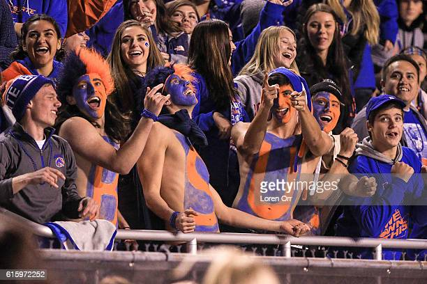 Boise State Broncos fans celebrate a Broncos victory and 70 record at the conclusion of second half action between the Brigham Young Cougars and the...