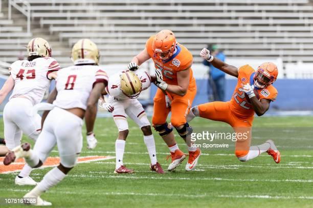 Boise State Broncos running back Alexander Mattison runs through line of scrimmage and stumbles over Boise State Broncos offensive lineman Ezra...