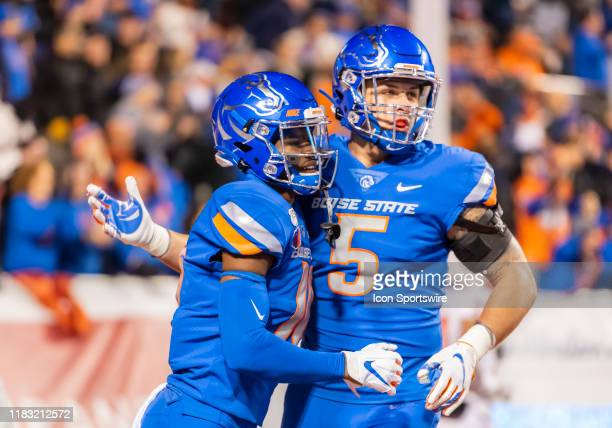 Boise State Broncos tight end Garrett Collingham congratulates Boise State Broncos wide receiver John Hightower on a score during the game between...