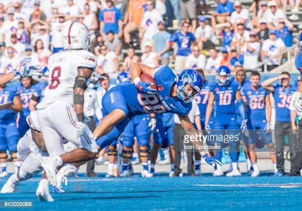 Boise State Broncos tight end Jake Roh reaches for extra yardage during the nonconference season opener between the Troy Trojans and the Boise State...